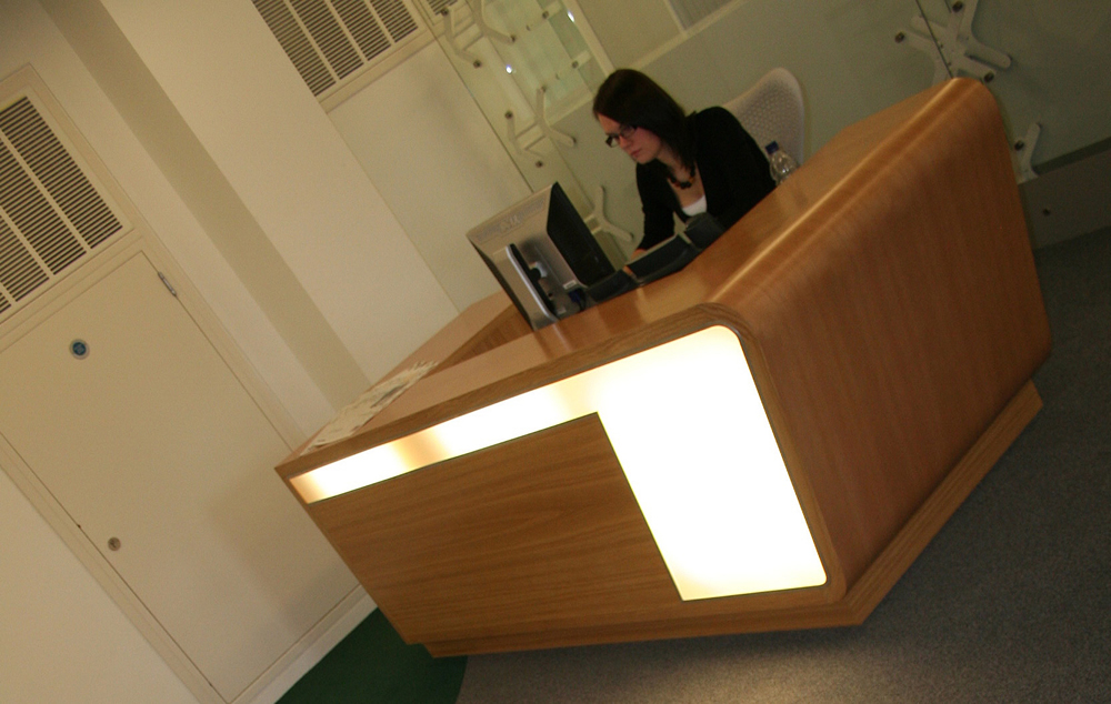 Curved oak reception desk
